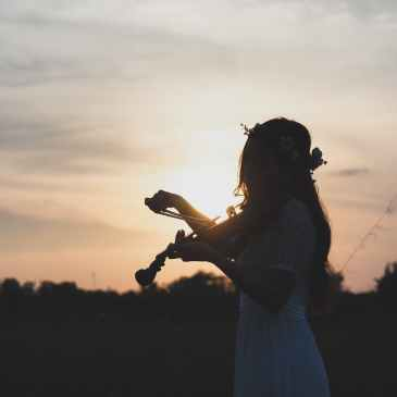 woman playing fiddle